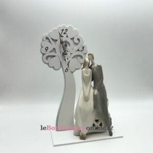 Orologio in legno con sposi in porcellana e led Mariella Martini