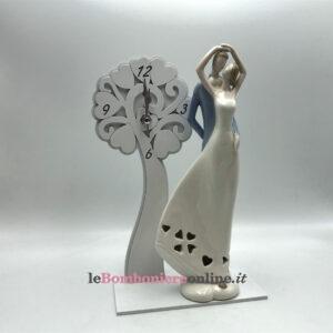 Orologio in legno con sposi in porcellana Mariella Martini